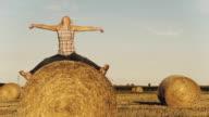 HD DOLLY: Joyful Woman On Hay Bale video