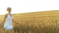 HD SLOW MOTION: Joyful Woman Running In The Wheat video
