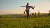 SLO MO Joyful woman spinning in meadow video