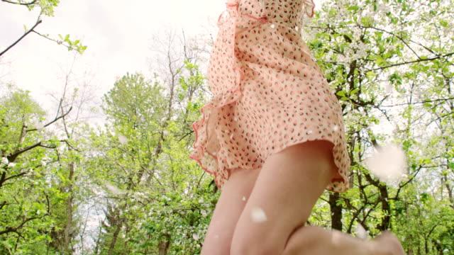 SLO MO Joyful woman under the falling petals video