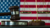 Judge calling order with hammer and gavel in american court with flag background video