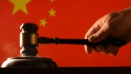 Judge calling order with hammer and gavel in china court with flag background video