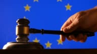 Judge calling order with hammer and gavel in EU court with flag background video