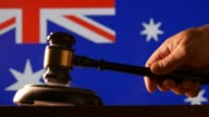 Judge calling order with hammer gavel in australain court with flag background video