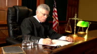 Judge in Court taking notes with USA flag, Courtroom video