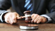 Judge with gavel on table video