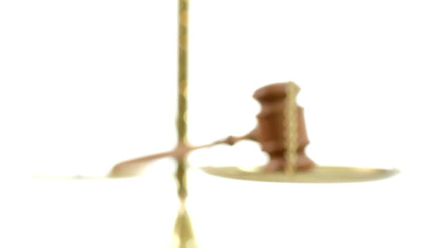 Judge's gavel resting on scales of justice. video
