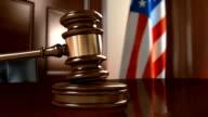 Judges's gavel hits striking block HD video