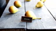 Juicy flavorful pears and text natural video