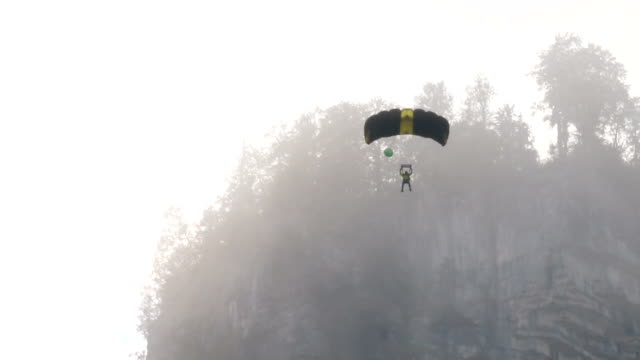 BASE jumper/wing suit flier descends from cliff video