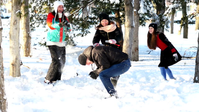 Jumping over another person in wintertime video