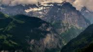 Jungfrau massif rock faces and alpine valley time lapse video