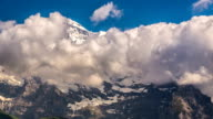 Jungfrau peak and glaciers clouds covering mountain time lapse video