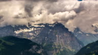 Jungfrau peak and rock walls  and mountainsides  Lauterbrunner time lapse video