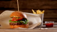 Junk food on wooden background. video