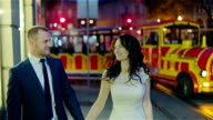 Just married couple walking night city video
