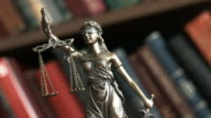 Justice scale with books video