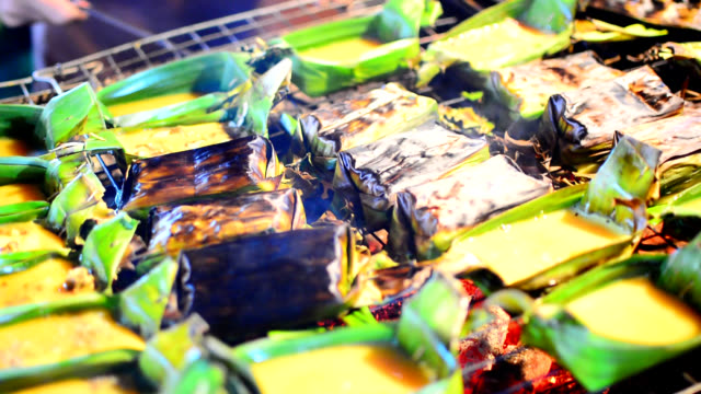 Kai-Pam, Grilled seasoned Egg in joist banana leaves, thai's traditional northern food. video