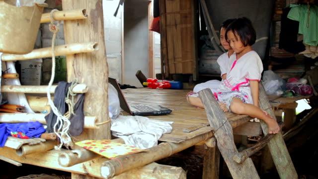Karen children enjoys learning to use laptop,Dolly shot video