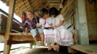 Karen children happy playing with the tablet video