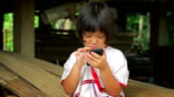 Karen girl is playing and showing Smart Phone video