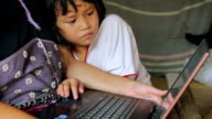 Karen girls learning to use a laptop video