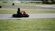 Kart drivers moving on a go kart track video