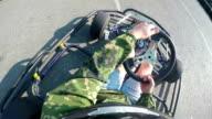 Karting driver rushes recreational go-kart on kart track camera on helmet video