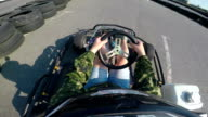 Karting female driver rushes on kart circuit outdoor camera mounted on helmet video