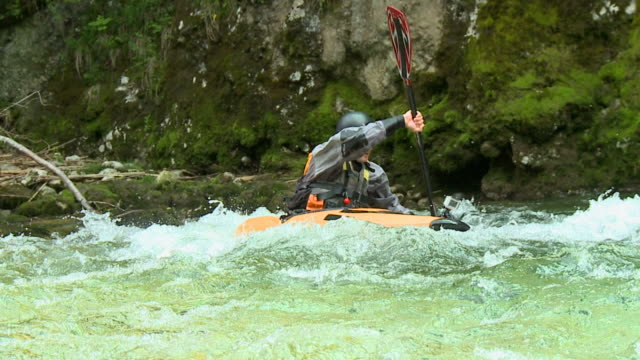 HD SLOW-MOTION: Kayaker  paddles past the camera video