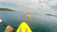 Kayaking after friend, escaping to boat and saving video