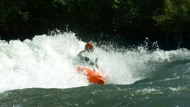 Kayaking in white water, super slow motion video