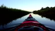 Kayaking on a canal in nature video