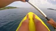 kayaking POV, sea horizon with sail boat  and island at background video