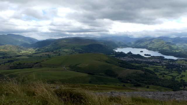 Keswick town Derwentwater and people on the path to Skiddaw video