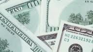 Key for house on one hundred dollar bills background video