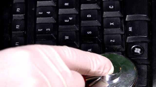 Keyboard examination with stethoscope on keyboard. Pc diagnostics video