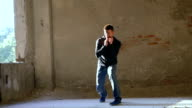 Kickboxer shadow boxing as exercise for the big fight in catacomb. Slow motion video