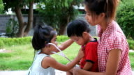 kid acting as doctor play with mother and brother, cute kid act as doctor cure brother and mother video