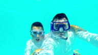 HD: Kid and father in swimming pool video