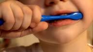 kid brushing teeth video