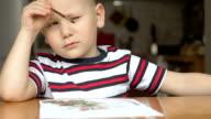 kid draws tassel a background. smart boy video