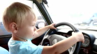 kid driving a car video