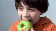 kid eating apple video