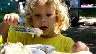 kid eating healthy food at home or kindergarten video
