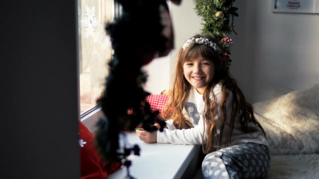 Kid Girl Having Fun near Windowsill video