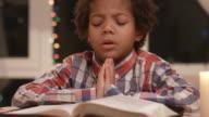 Kid is praying. video