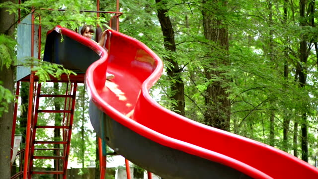 Kid Playing in Park, on a Slide video
