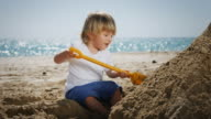 Kid playing with sand video