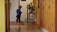 Kid runs and climbs some steps video